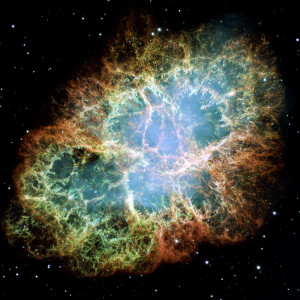 The Crab Nebula is actually a remnant of a supernova and contains a pulsating star in its center. A supernova is actually an exploding star. What makes this particular nebula so interesting is that it was observed and recorded by Chinese astronomers as early as 1045 AD. Source: http://hauntinglybeautifulhubbleimages.blogspot.com/